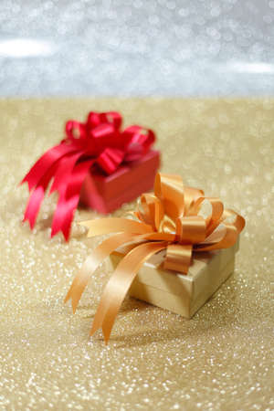 edel: Christmas gift on Decorative background in silver and gold backgrounds.;