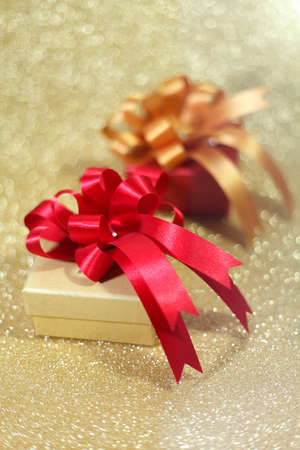 edel: Christmas gift on Decorative background in gold.