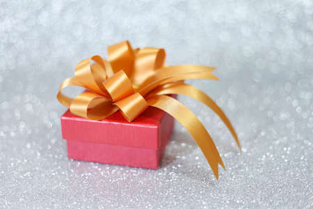 edel: Christmas gift on Decorative background in silver.
