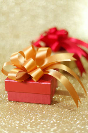 edel: Christmas gift on Decorative background in gold.;