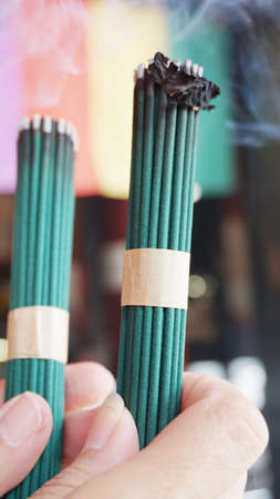 Green with incense smoke, worship in Japan.