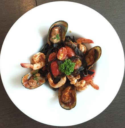 prepared shellfish: The black spaghetti with seafood close up Stock Photo