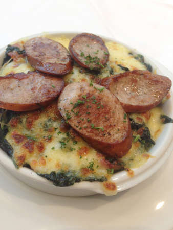 Spinach and parmesan cheese with Sausage Stock Photo