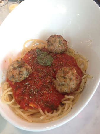 plate of spaghetti with meatballs in tomato marinara sauce and ingredients Stock Photo