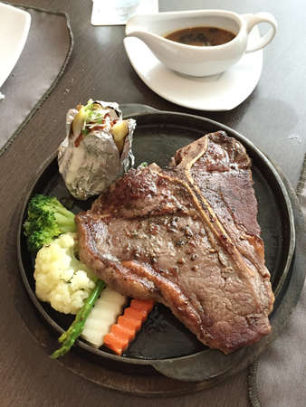 Tbone steaks in Australia large t bone steaks cooking on a charcoal grill