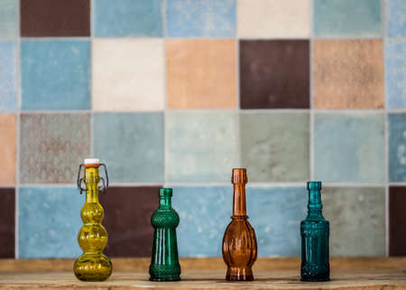 Colorful Phials and colorful tiles photo