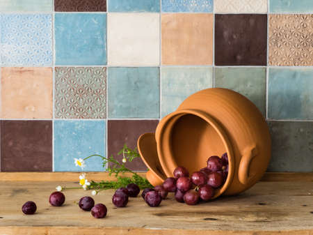 rustic kitchen: Rolling grapes in a rustic kitchen