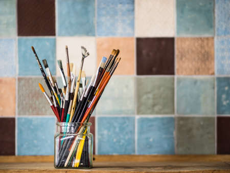 goffer: Paintbrushes in a jar Stock Photo
