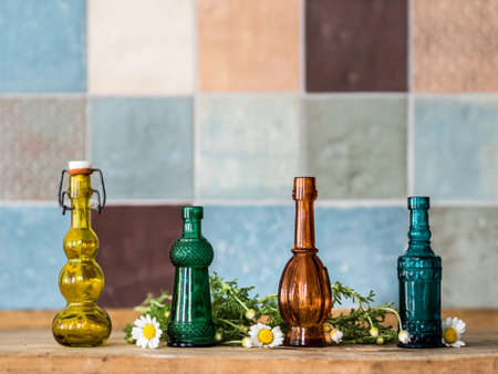 Phials tiles and chamomile photo