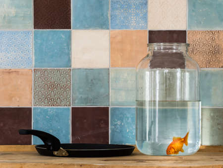 fluency: Goldfish tiles pan and jar Stock Photo