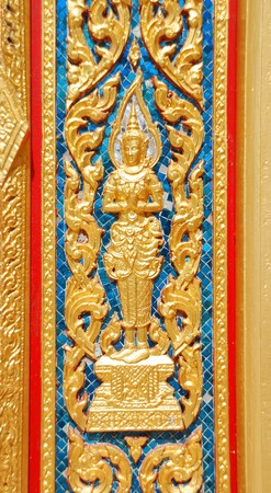 Sum up the door of the temple in Thai architecture and decorated with golden stucco designs photo