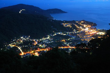 High angle of Phuket Town in the valley at night