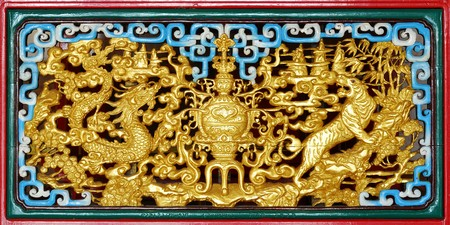 wood carving: Gold pattern on a piece of carved wood Chinese art