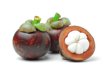 Mangosteen is a tropical fruit, white meat, dark purple rind Stock Photo