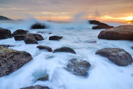 Sea waves lash line impact rock onthe beach Stock Photo - 14658074