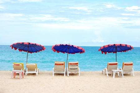 Beach chair. Sunbathing on the beach at the resort during the summer season looks Stock Photo