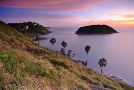 Cape is a mountain of rock that extends into the sea in Phuket, Thailand