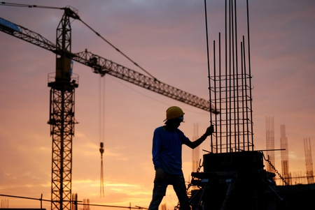 Black silhouette of the building construction is not finished. Stock Photo