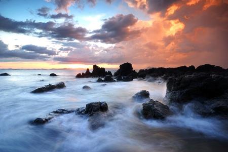 sea line: Sea waves lash line impact rock onthe beach