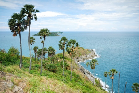 extends: Promthep Cape is a mountain of rock that extends into the sea in Phuket, Thailand Stock Photo