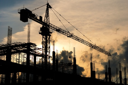 silhouette Construction site at sunset Stock Photo