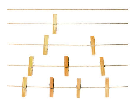 clothes peg: collection of peg on rope ,white background
