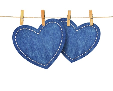 clamps: jean hearts hanging from a rope, on red wallpaper. Part of Valentines day set.