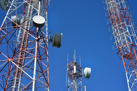 transmitter: Telecommunication tower with a  sunlight  Used to transmit television signals  Stock Photo
