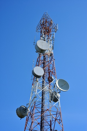 telecommunication equipment: Telecommunication tower with a  sunlight. Used to transmit television signals.