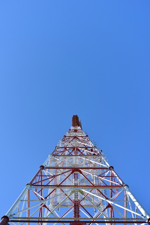 tv station: Telecommunication tower with a  sunlight. Used to transmit television signals.