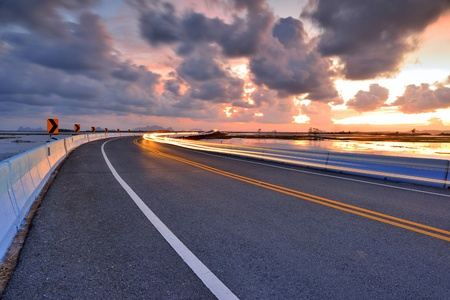 asphalt road to horizon at twilight Stock Photo