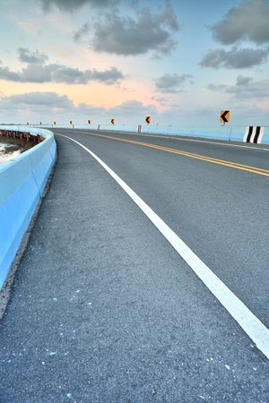 vertica: asphalt road to vertical in cloudy sky  Stock Photo