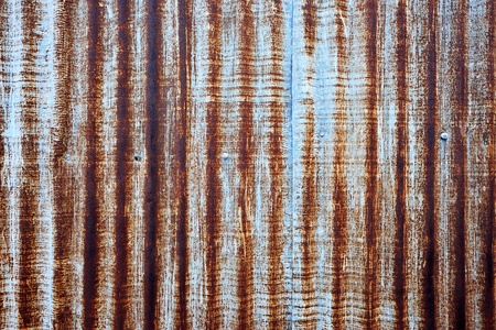 A rusty corrugated iron metal fence Zinc wall