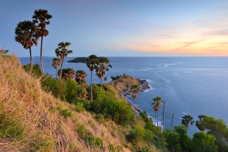 viewpoints: Promthep Cape is a mountain of rock that extends into the sea  view point sunset in Phuket, Thailand