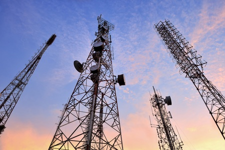 telecommunication equipment: Telecommunication tower with a  sunlight  Used to transmit television signals  Stock Photo