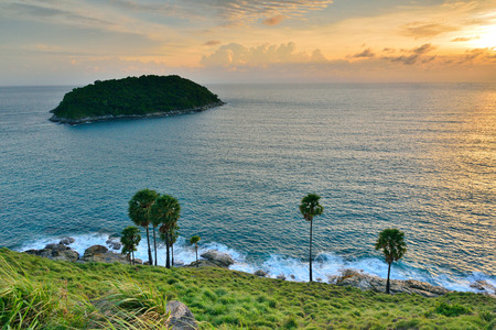 extends: Cape is a mountain of rock that extends into the sea in Phuket, Thailand