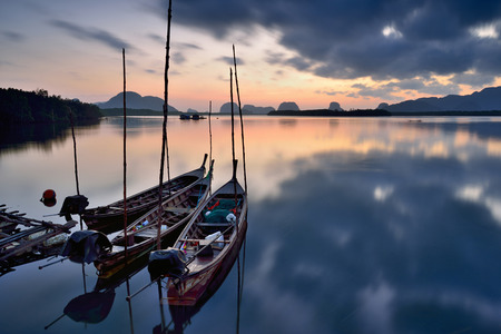 longtail: Traditional thai longtail boats at sunset ,thailand Stock Photo