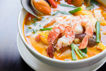 Tom yum soup ,Tom yam is a spicy clear soup typical in Thailand ,Thai Dish Cuisine. photo