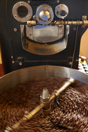 Coffee beans in the roasting machine Stock Photo