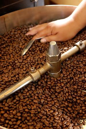 roasting: Coffee beans in the roasting machine Stock Photo