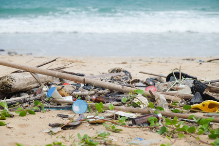 Dirty garbage on the beach causes environmental pollution