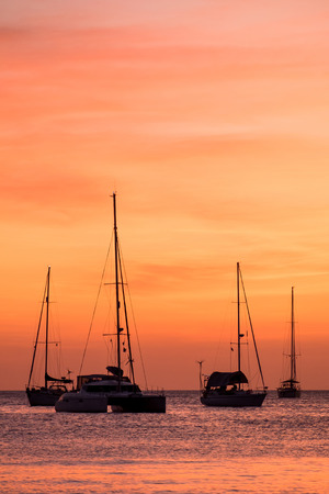 water sports: silhouette of sail boat on sea at sunset ,phuket,thailand