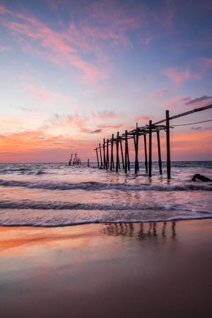 pier: Old wooden bridge in the sea with sky sunset