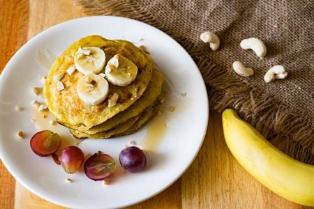banana cashew pancakes with bananas,salted caramel sauce and grape fruit. selective focus Stock Photo