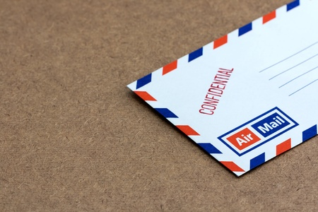 Confidential envelope on wooden background