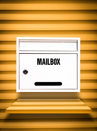 White Mailbox on yellow shelf photo