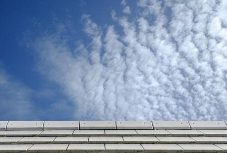 slate roof: Slate roof against blue sky
