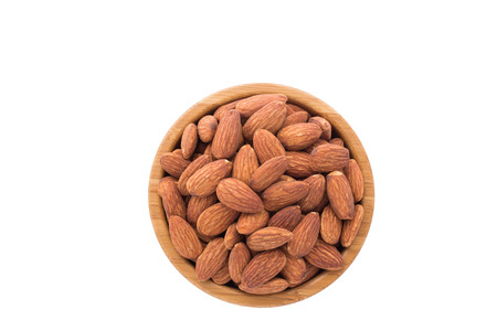 Almonds in the bowl with white background