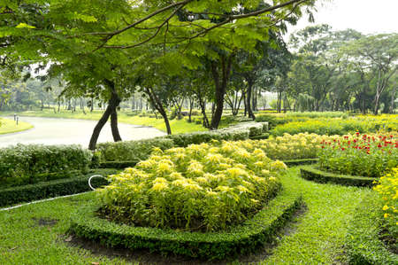 Flowerbeds and lawn in Park photo
