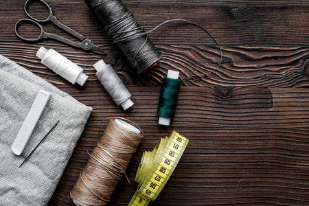 tools for sewing for hobby set on wooden background top view mock up Stock Photo